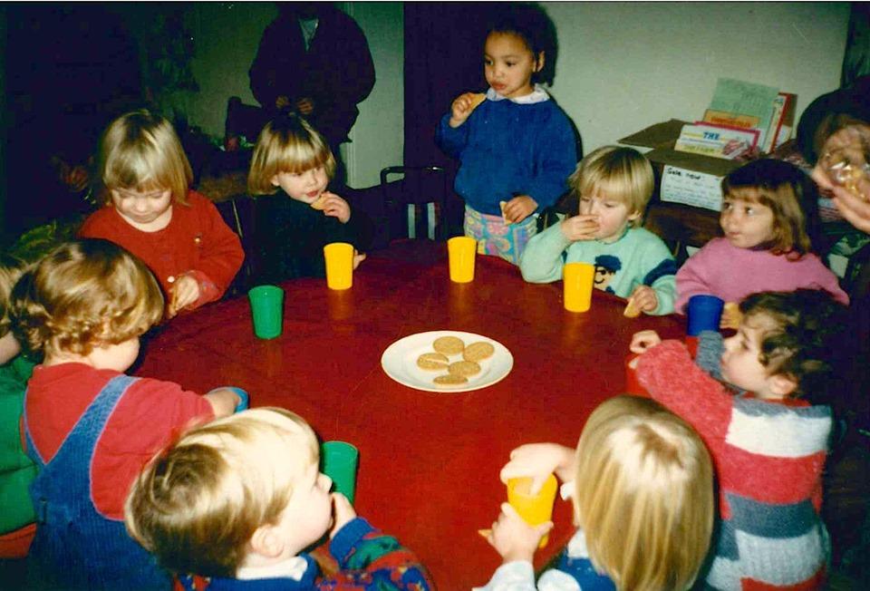 Snack time at Martha's mum's pre-school. Martha aged 3.